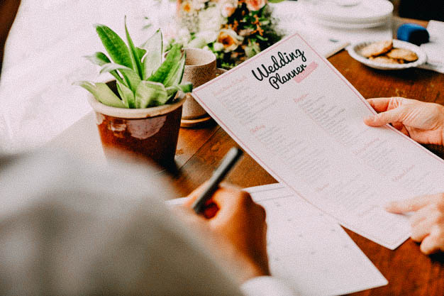 Hands Holding Wedding Planner Checklist Information Preparation